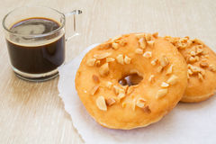 Peanut butter donuts with black coffee Royalty Free Stock Photography