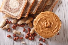 Peanut butter and fresh bread horizontal top view Royalty Free Stock Images