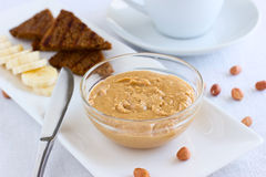 Peanut butter in a glass bowl Royalty Free Stock Image