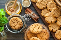 Peanut butter and honey cookies on a dark wood background Stock Images