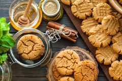 Peanut butter and honey cookies on a dark wood background Royalty Free Stock Photography