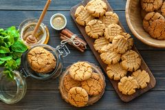 Peanut butter and honey cookies on a dark wood background Stock Photos