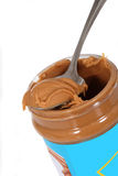 Peanut butter jar. Close up of peanut butter jar and spoon stock photo
