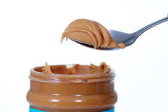 Peanut butter jar. Close up of peanut butter jar and spoon stock images