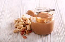 Peanut butter in a jar. On wooden table stock images
