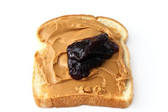 Peanut butter and jelly. Slice of white bread with peanut butter and grape jam on white Stock Image