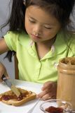 Peanut Butter and Jelly 2. A young child makes a peanut butter and Jelly sandwich stock images