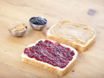 Peanut butter and jelly sandwich. On table stock photography