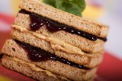 Peanut Butter and Jelly Sandwich. Garnished with a Sprig of Mint stock photography