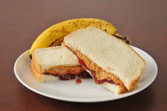 Peanut butter and jelly sandwich with a banana. A peanut butter and jelly sandwich with a banana stock images