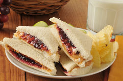 Peanut butter and jelly sandwich. A peanut butter and jelly sandwich with the crust trimmed off stock image