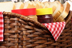 Peanut butter and jelly sandwich ingrdients. Peanut butter and jelly sandwich ingredients on basket with jars and bread stock photos