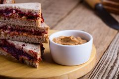 Peanut butter and jelly sandwich. With whole wheat bread on rustic wooden table Stock Images
