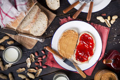 Peanut butter and jelly sandwich on a rustic table Stock Photography