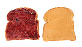 Peanut Butter Jelly Sandwich Slices. Peanut butter and jelly sandwich on bread slices isolated on white background royalty free stock photo