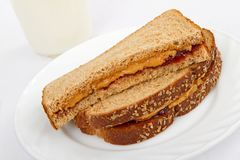 Peanut Butter and Jelly Sandwich on Whole Wheat Stock Images