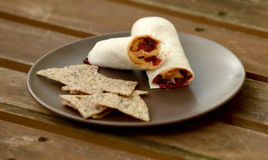 Peanut butter and jelly wrap with chips Royalty Free Stock Photos