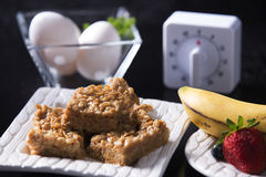 Peanut Butter Marshmallow Squares, Eggs, Timer & Fruits Stock Images