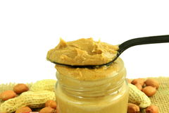 Peanut butter and peanuts whole and peeled in white  background Stock Photo