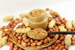 Peanut butter and peanuts whole and peeled in white  background Royalty Free Stock Photo