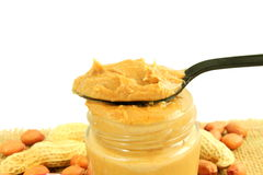 Peanut butter and peanuts whole and peeled in white background royalty free stock images