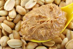 Peanut butter on roasted nuts Royalty Free Stock Photography