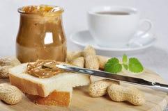 Peanut butter sandwhich. Fresh homemade peanut butter sandwhich and peanuts on wooden cutting board Stock Photography