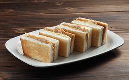 Peanut butter sandwich. A plate of toast with peanut butter Royalty Free Stock Image