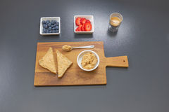 Peanut butter sandwich, fruits and coffee. Breakfast: peanut butter sandwich with fruits (strawberries & blueberries), and coffee royalty free stock photography