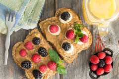 Peanut butter sandwiches with berries and cheese Stock Photography