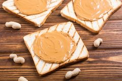 Peanut butter sandwiches or toasts on wooden. Background stock photos