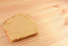 Peanut butter on a slice of bread Royalty Free Stock Image