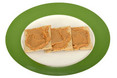 Peanut Butter Spread on Seeded Crackers Royalty Free Stock Photos