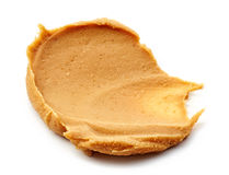 Peanut butter spread  on white Royalty Free Stock Images