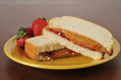 Peanut butter and strawberry jam sandwich Royalty Free Stock Photo