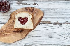 Peanut Butter and Strawberry Jelly Sandwich with Cut Out Heart stock photo