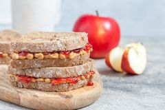 Peanut butter and strawberry jelly sandwich Stock Images