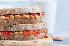 Peanut butter and strawberry jelly sandwich Stock Photos