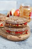 Peanut butter and strawberry jelly sandwich. With apple stock photo