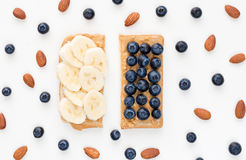 Peanut butter toast with banana and blueberries Royalty Free Stock Images