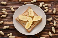 Peanut butter toast with banana slices stock images