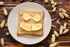 Peanut butter toast with banana slices. stock image