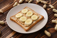 Peanut butter toast with banana slices stock photo