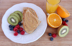 Peanut butter toast with fruit Stock Photo
