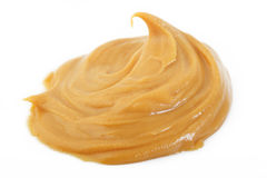 Peanut butter. On white background royalty free stock photos