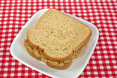 Peanut butter on whole wheat bread Royalty Free Stock Photography