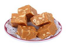 Peanut Butterscotch Fudge. On a plate isolated on white stock photo