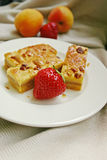 Peanut Cake and Strawberry Treat. Peanut cake, strawberry and peach Stock Image