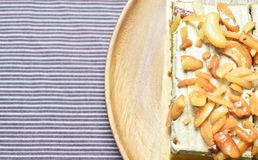 Peanut and cashew nut cake. On wooden plate Stock Photo