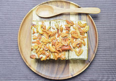 Peanut and cashew nut cake. On wooden plate Stock Photography